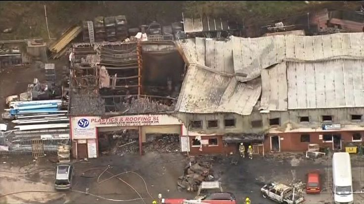 The families of two men killed in a blaze at a fireworks warehouse have said they are still without answers two years on.