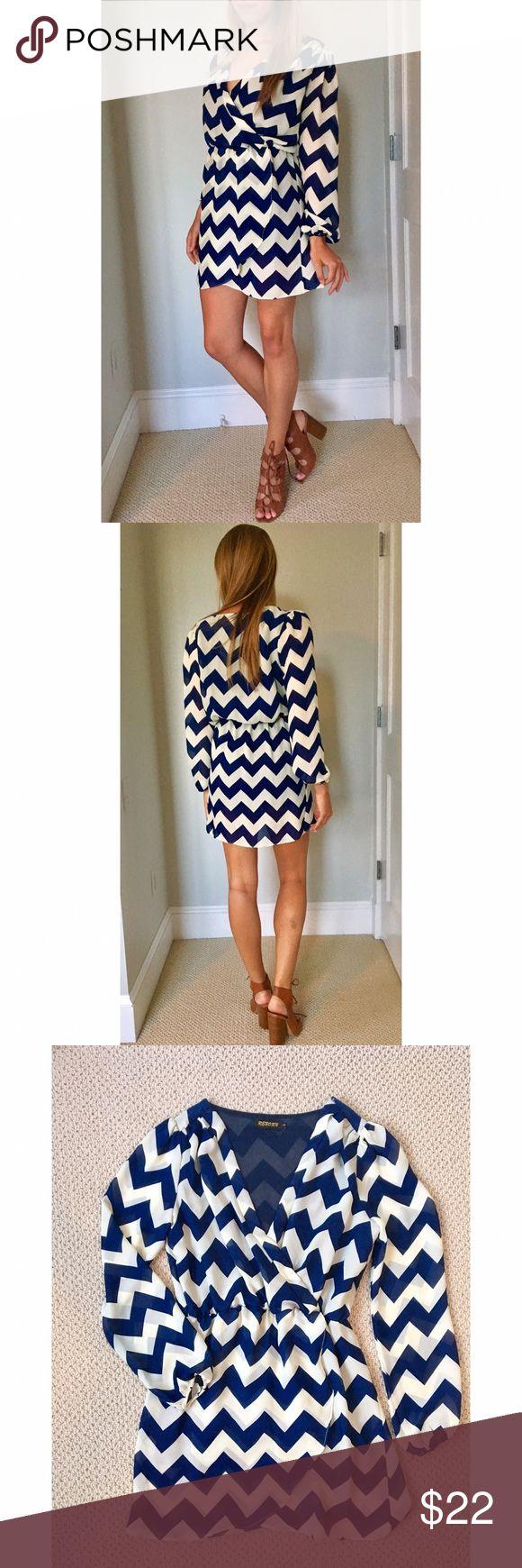Chevron Long-sleeve Dress Navy and white nautical chevron chiffon lined long sleeve dress. Worn once Reborn Dresses Mini