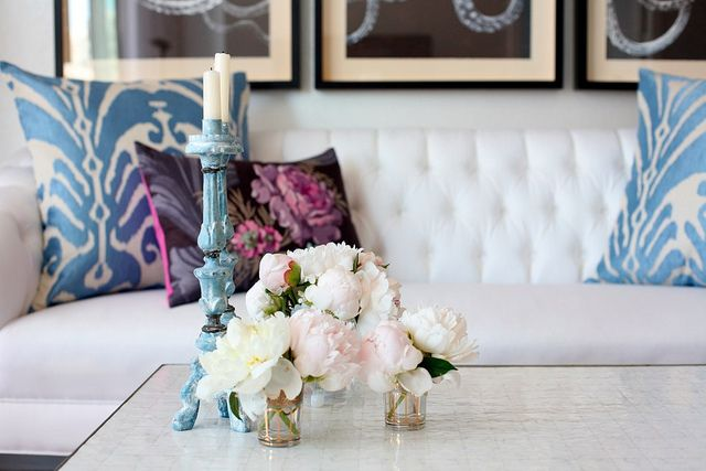 Nice collection of several small vases in a space that doesn't look too eclectic but add variety from single arrangements.
