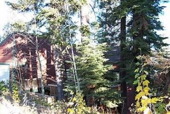 PINE, PINE AND PINE! This lovely remodeled Tahoe Cabin Rental has a hot tub on the back deck with a peak of Lake Tahoe, and views of the golf course and majestic Sierra Mountains beyond! The home has ...