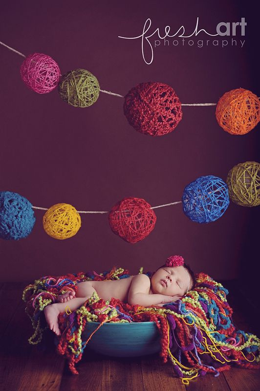 Photog says to buy scads of yarn and throw it in a bowl. I also love the yarn balls hanging overhead (@LeAnn Scacco @Rebecca Ligtenberg - don't these remind you of the felted wool we saw in the store at Oakbrook?).