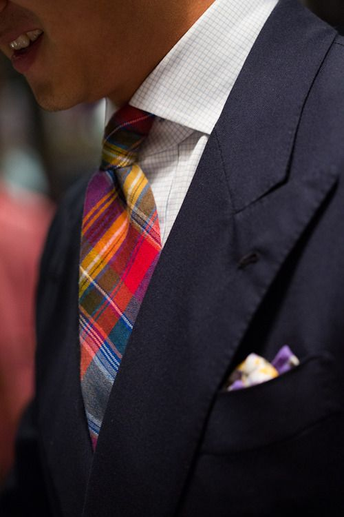 Navy jacket, white check shirt, plaid tie