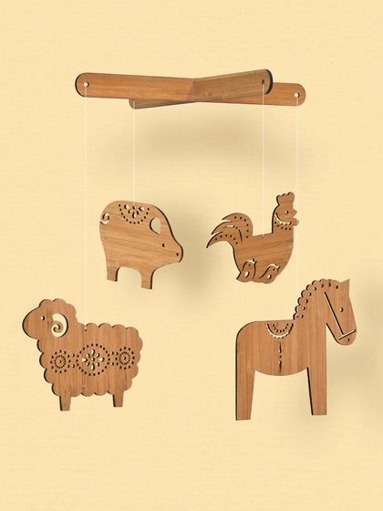 "2. Wooden Mobile by Petit Collage – ""A darling mobile adds a little bright focal point to the nursery. These bamboo laser-cut wooden mobiles by Petit Collage are Project Nursery favorites."""