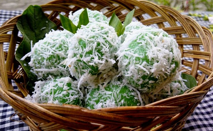 Klepon is a traditional green-coloured balls of rice cake filled with liquid palm sugar and coated in grated coconut. The small pieces of palm sugar initially was hard when it was inserted into glutinous rice dough and rolled into balls. The balls then being boiled, subsequently the palm sugar melted due to high temperature, creating a sweet liquid inside the balls core. Images courtesies by google #Bali #Seminyak #nice  #holiday  #honeymoon  #tonysvilla #balimagic www.balitonys.com