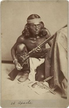The Apache scout Nantaje, receives the Congressional Medal of Honor for action against the Apaches, April 12, 1875. Nantaje holding a M1870 rifle cal 50-70 and cartridges in his hand. A Smith & Wesson American Model 1 and a knife are on the ground before him. At the end of the day, Nantaje and other scouts had helped divert the Indians. 76 of them were killed. Nantaje and other Apache scouts received the Congressional Medal of Honor for this commitment.