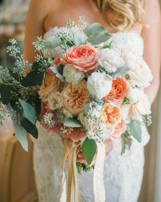 This bride carried a pastel bouquet of dahlias, begonias, dusty miller, and roses down the aisle. See more of this garden-party wedding in San Francisco!