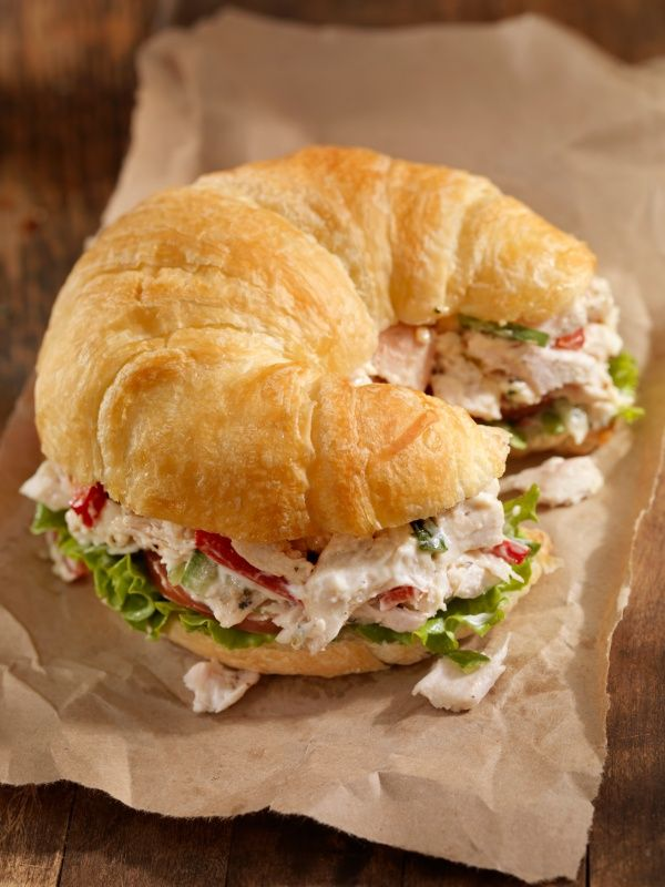 Southern Style Chicken Salad with Red Grapes and Pecans, a layer of lettuce and placed on mini croissants with toothpick skewers... I love this idea!