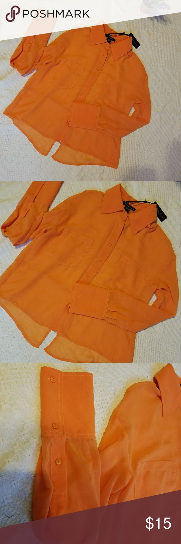 Caribbean Queen button down top This is an adorable Caribbean Queen button down top with slit in the back. Two front pockets and can roll up sleeves. Caribbean Queen Tops Button Down Shirts