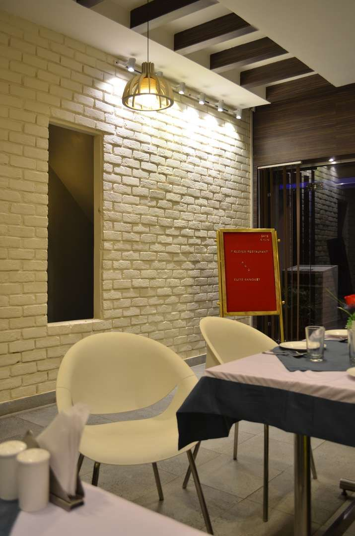 F Eleven Restaurant: An Indian fusion restaurant with an brick  patterned textured wall
