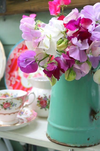 "Nothing says ""Spring is here!"" like the soft fragrance of a jug full of sweet peas."