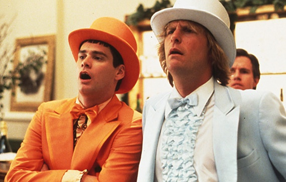 "DUMB & DUMBER (1994)  Harry: ""I expected the Rocky Mountains to be a little rockier than this.""    Lloyd: ""I was thinking the same thing. That John Denver's full of s**t, man.""      The third major outing for Jim Carrey saw the elastic-expressioned comic playing Lloyd. a Jerry Lewis-type dimwit with a dream.    One day, Lloyd finds a briefcase and persuades his equally thick pal Harry to head to Colorado and return to the case to its rightful and gorgeous owner Mary."