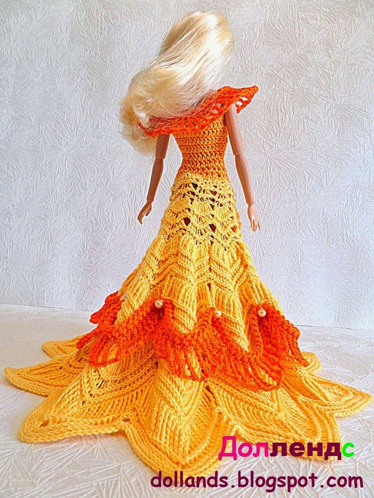 Наряд для кукол барби. Юбка очень длинная, ярусами расходится в стороны, украшена оранжевыми воланами.