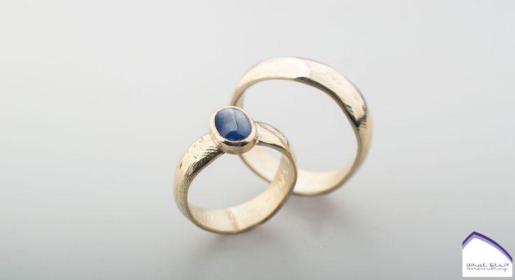 Geelgouden trouwringen met Saffier,