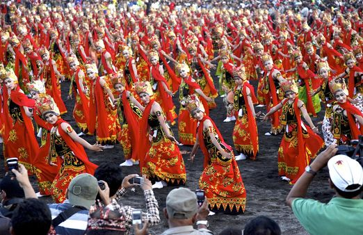 A festival that lasts for months in Banyuwangi, East Java. One thousand dancers dancers dressed in traditional attire perform for the Paju Gandrung Sewu show at the beach.