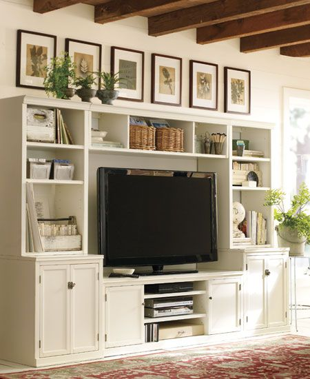 some custom version of this. art above is a nice option. so are floor to celing shelving abilities.
