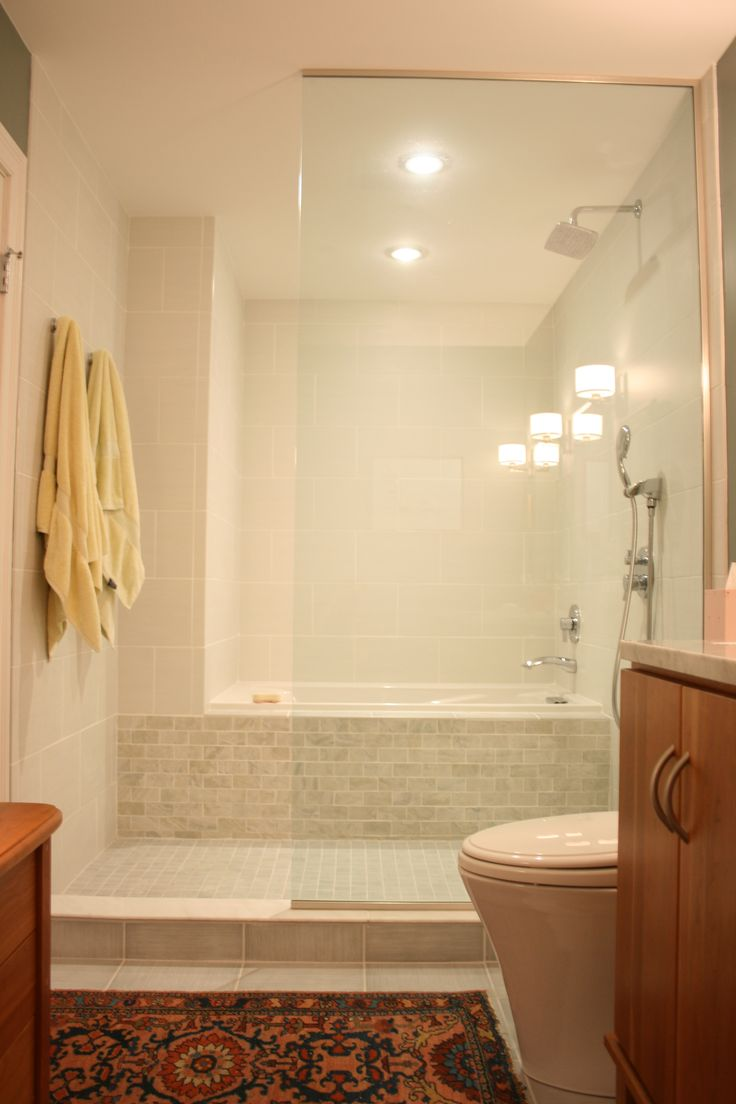 Neat idea for long, narrow baths to make them seem bigger... bathtub/shower combo idea
