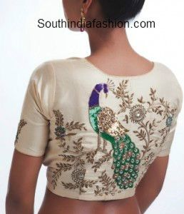 High neck saree blouse with peacock embellished over the back. Related PostsCollar Neck Net Blouse DesignsTrendy Collar Neck Designer BlouseBeautiful Blouse Design for Silk SareesPeacock Design Maggam Work Blouse