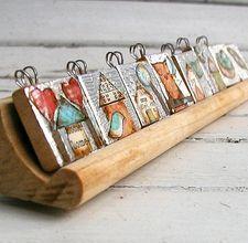 display small flat pendants in wooden scrabble tile holders