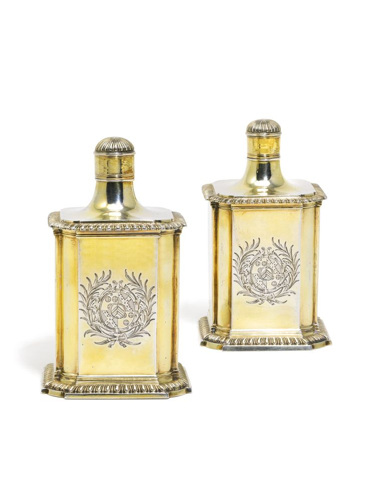 1766 pair of George III silver-gilt scent flasks, Parker & Wakelin;  shaped square, gadroon borders, each engraved with a coat-of-arms within a rococo cartouche, screw-on covers.