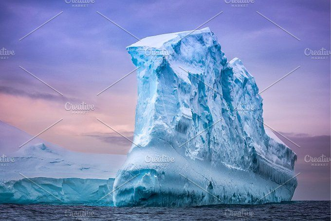 Antarctic iceberg in sunset by Volodymyr.Goinyk on @creativemarket