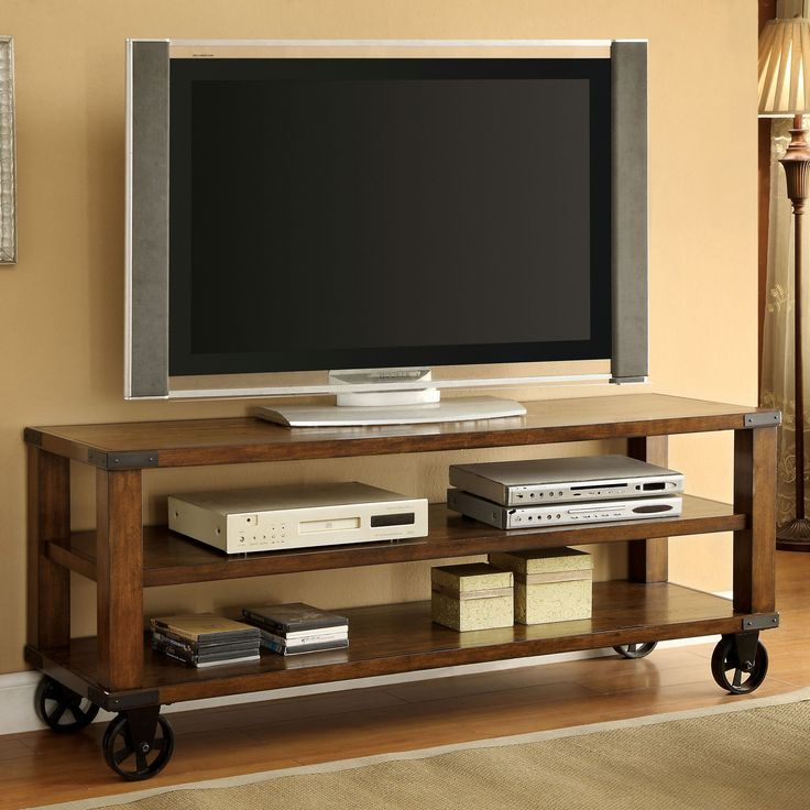 Stunningly crafted from solid wood and veneers, this TV stand features a mobile design that is sure to draw attention. The open design is a great way to display your treasured electronics while upholding your expansive television atop.