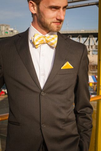 Modern groom with bright yellow bow tie and pocket square