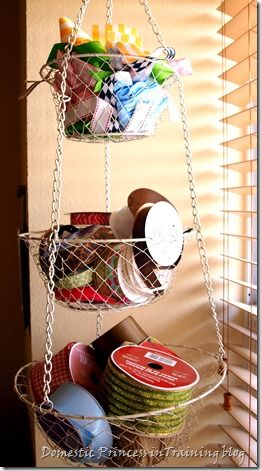 New use for those ugly old fruit/veggie baskets...craft room storage!  You could even add some spray paint to coordinate w/decor!