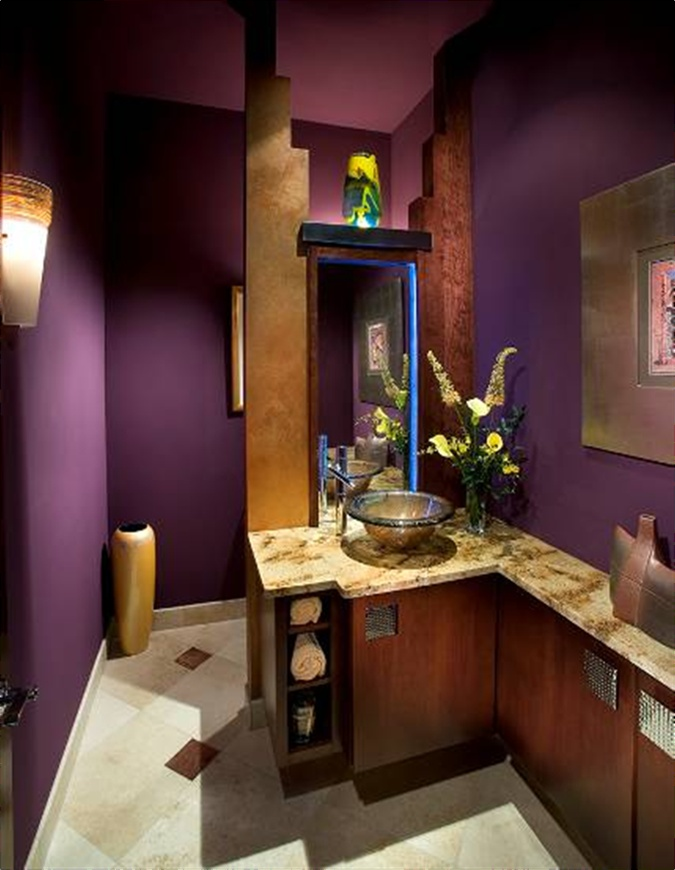 What do you say to a small bathroom? Color it purple, it makes it intimate, not small! Designed by Marcia Graber