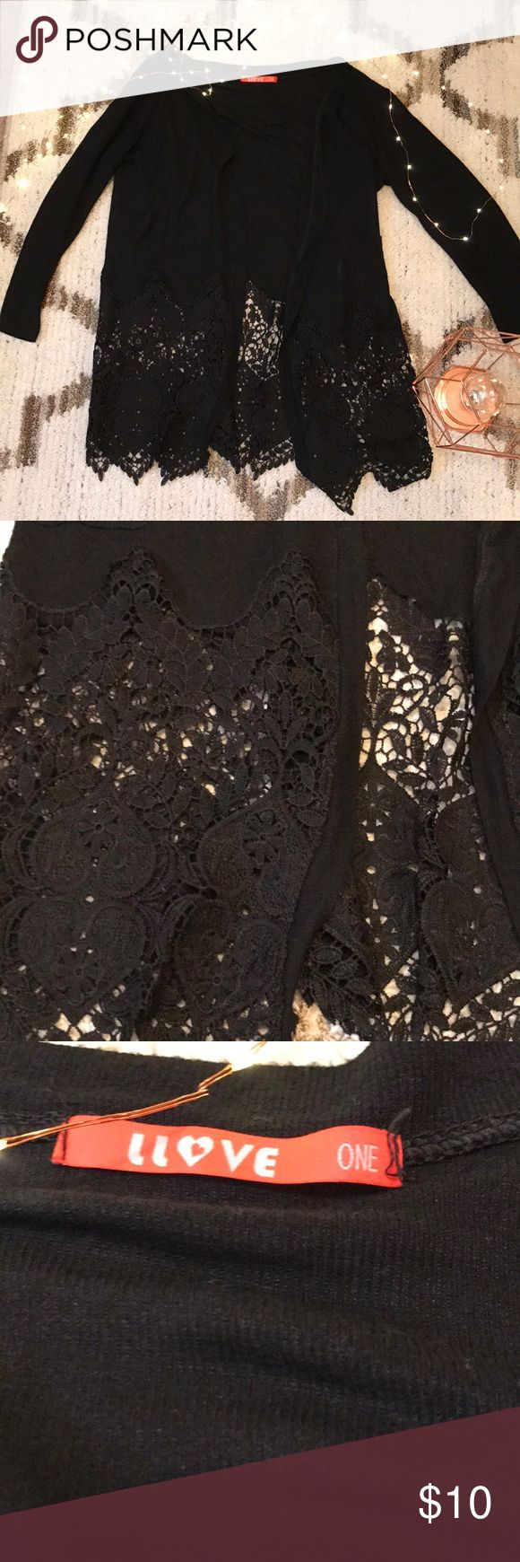 Black Lace Cardigan Black Light weight Cardigan with beautiful lace detail on the bottom  There are two small pockets near the bottom Long sleeve  I did not find a size listed.  It looks like it may say one size but I'm a small and it fit me great! Only worn once or twice! Fabulous condition! Bought from boutique LLove Sweaters Cardigans