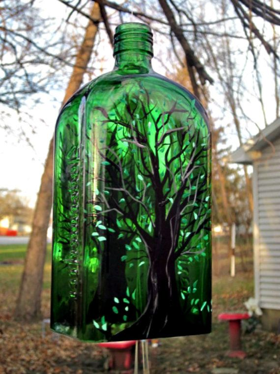 Wind Chime made from a Jagermeister Bottle. Great looking and sounding wind chime. Bottom has been cut off and sanded smooth. A tree with green