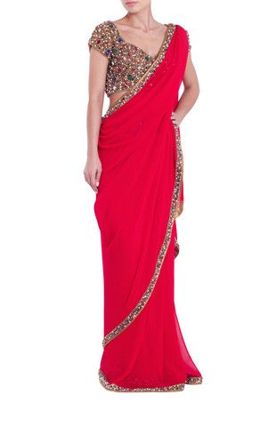 Seema Khan Dazzling ruby red saree with heavy jewelled, hand-work border. Contrasting multi-jewelled statement blouse included. #Saree #Sareeblouse #Bollywoodfashion #Designer