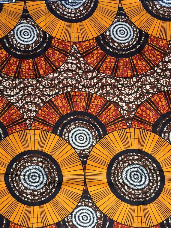 Impression : Recto Matière : polyester/coton Largeur : 46 Texture : Pas ciré Couleurs principales : Orange, marron, rouge, bleu marine Coupe du tissu : Achat de 1 + yards par client sera coupé comme 1 continu pièce de tissu jusquà une longueur maximale de 6 yard. FABRIQUANT : tous
