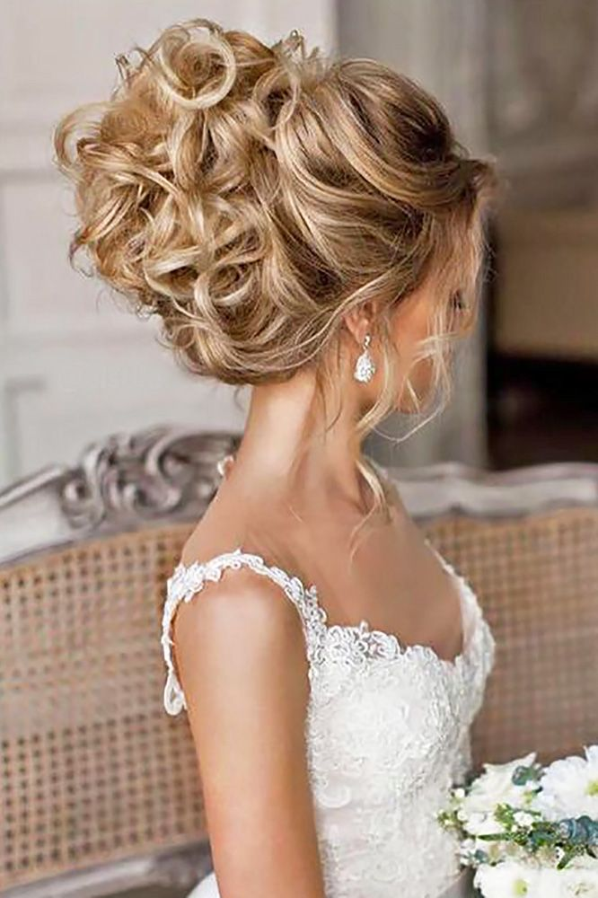 If you are not sure which hairstyle to choose, see our collection of swept-back wedding hairstyles and you will find gorgeous and fancy looks! Use some pins and wand to pull back your hair into an elegantly messy updo. Release just a few wavy strands in the front and get such a lovely style!