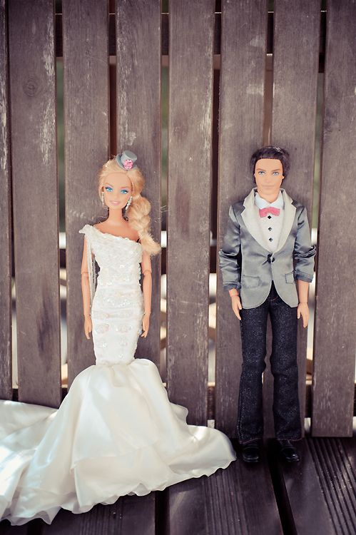 Newly-Wed Game: Have bride and groom sit in chairs back to back, give them each a Ken and Barbie (representing the groom and bride). Then ask them questions such as: who instigated the first kiss? , who wears the pants in the relationship? or who has control of the remote? And have them raise either Ken or Barbie as their answer! So cute! :) not so sure about the barbie & ken thing but cute idea..