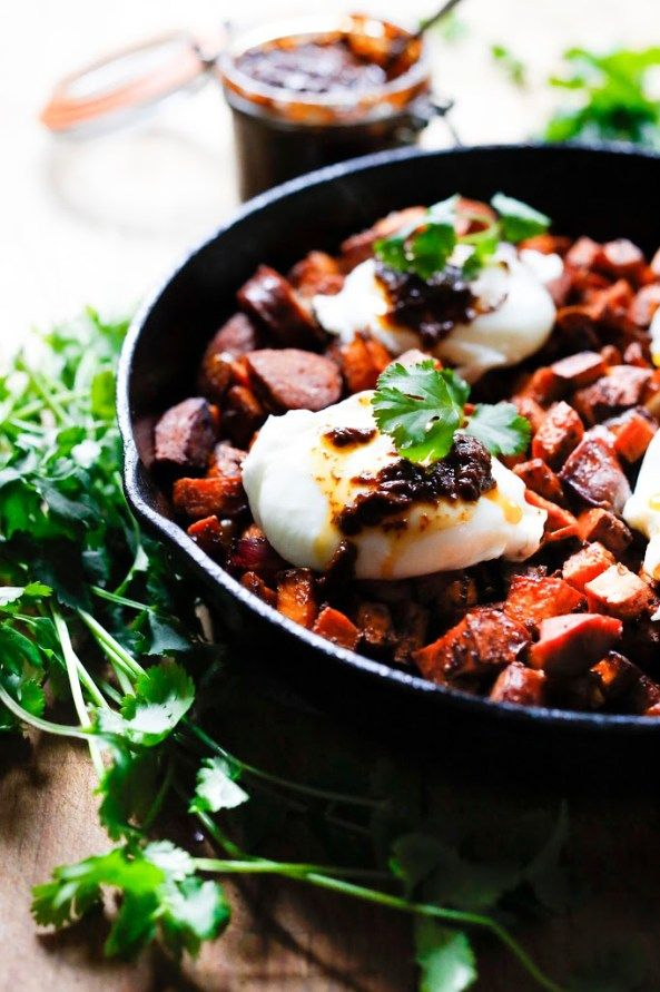 Sweet Potato Hash with Harissa and topped with pillowy Poached Eggs  | feastingathome.com