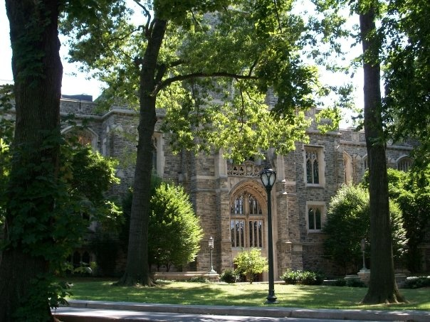 fordham college logo. the former library on bronx campus, duane library, rose hill, fordham university college logo