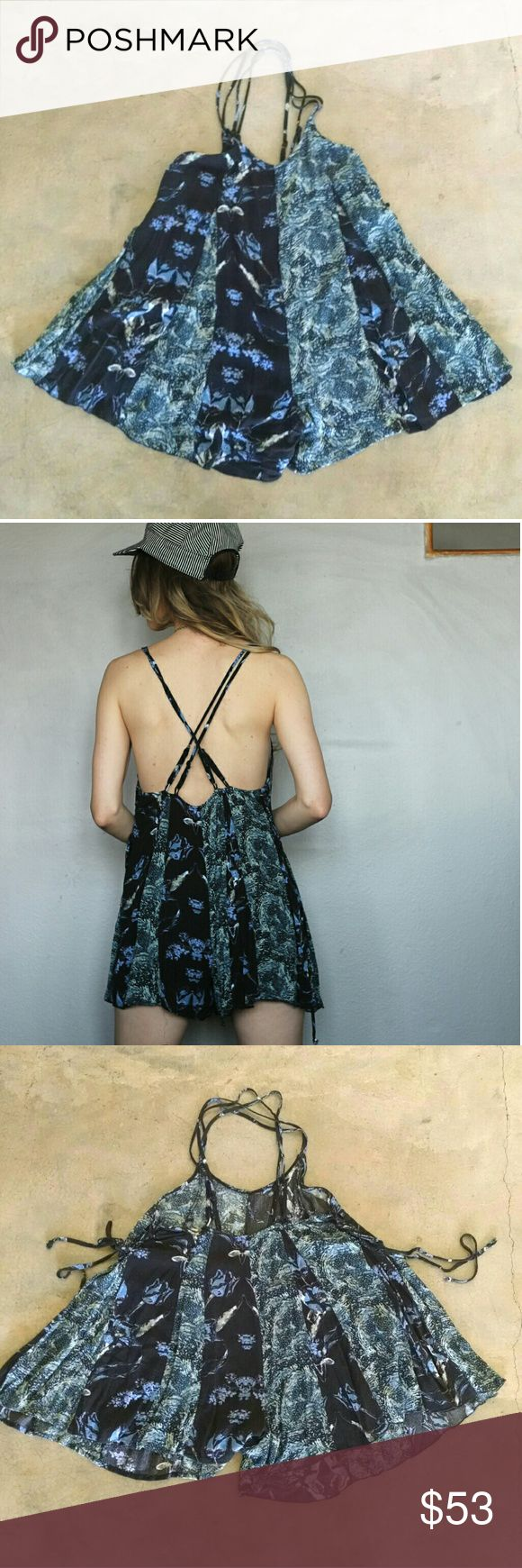 """🍄 Free People Flowy Romper Playsuit Adorable comfortable Free People playsuit strappy - free flowing - buffet - day drinking friendly fit tag size xs fits xs-s and prob fine for m too. So cute shown on 5'8"""" size s/4. mild fading/pilling and a couple of stray threads at edges/straps - looks great overall.   Tags beach festival playsuit romper shorts FP 90 grunge bohemian shorts resort vacation floral Free People Pants Jumpsuits & Rompers"""