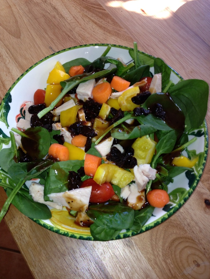 Spinach Salad with chicken, dried berries and veggies.