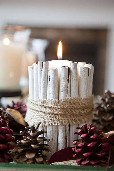 Painted cinnamon sticks around candle with burlap