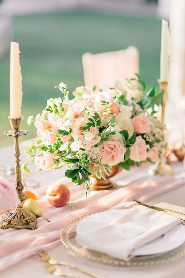 white blush pink peach and green centrepieces | blush linens and gold cutlery with gold beaded charger plates