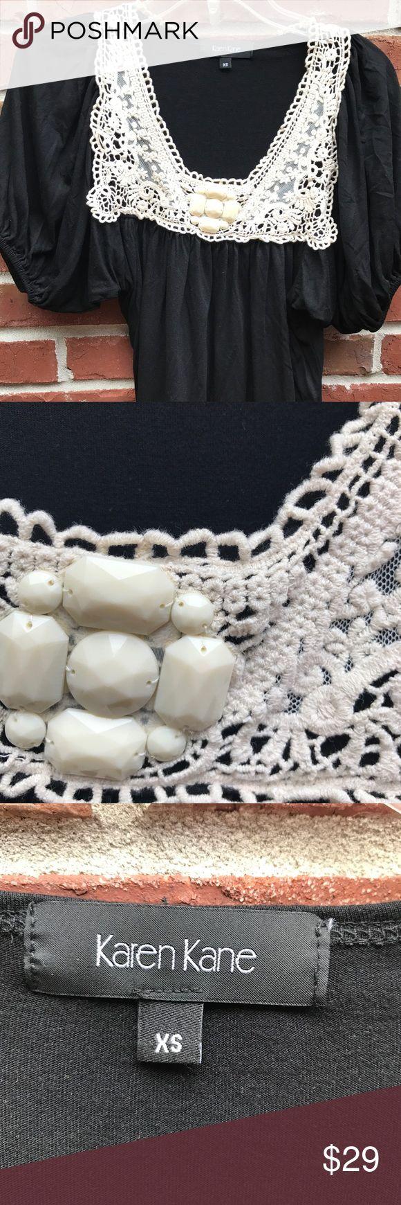 Karen Kane XS Black Knit Top with Ivory Lace Karen Kane XS Black Knit Top with Ivory Lace. Excellent condition. Karen Kane Tops Blouses
