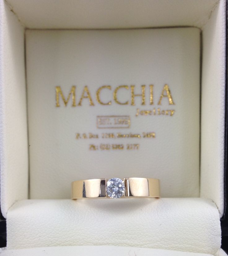 Diamond ring, tension set in square edge 18ct yellow gold band. Made by Macchia Jewellery, Horsham, AU