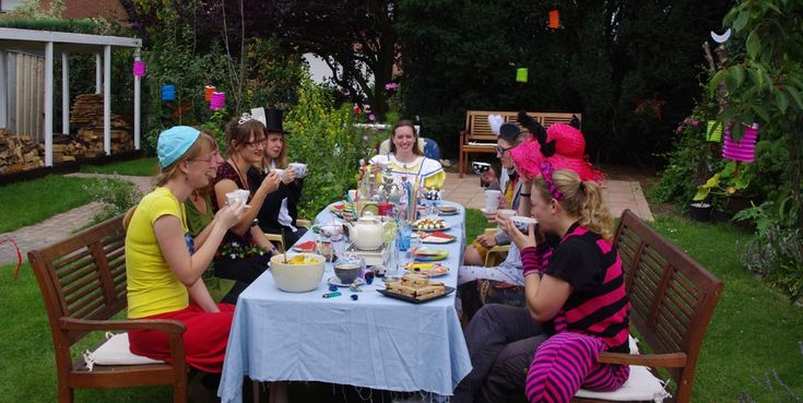 Me and my friends at the Mad Tea Party table, drinking tea of course.