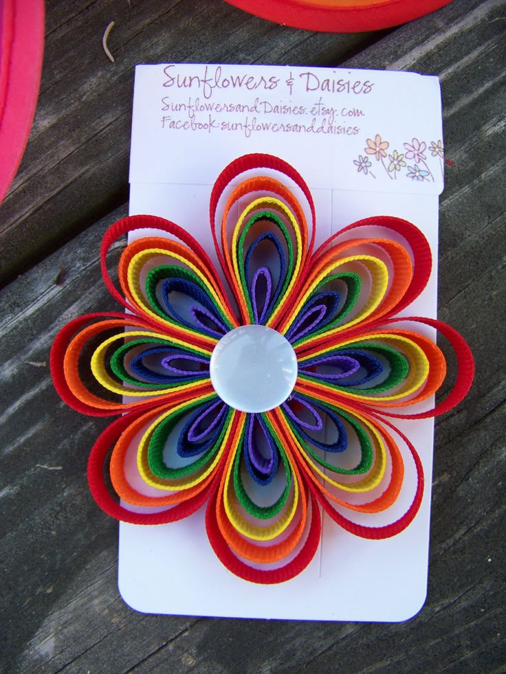 Rainbow Ribbon Flower Hair Clip/Barrette with White Button Center- Rainbow Birthday Party Bow. $6.50, via Etsy.