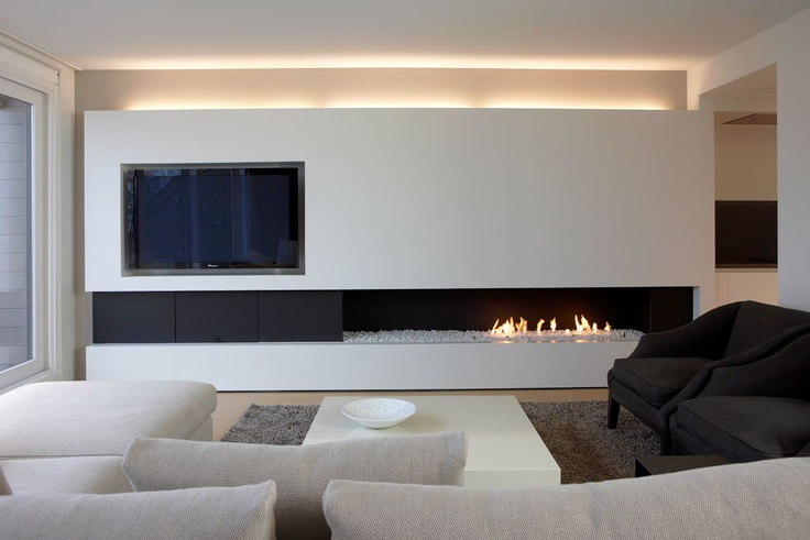 TV with offset fireplace, so stacked rectangles don't get visually distracting, yet you won't have to sacrifice warmth. #dreamlivingroom #dream living room