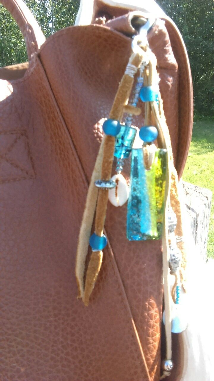 Purse Tassel made with Moosehide and Upcycled Jewelry pieces