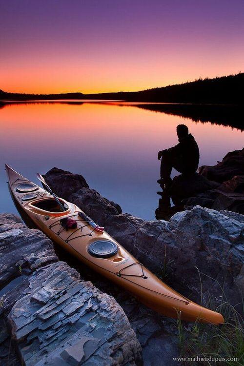 Still water sunset with sea kayak