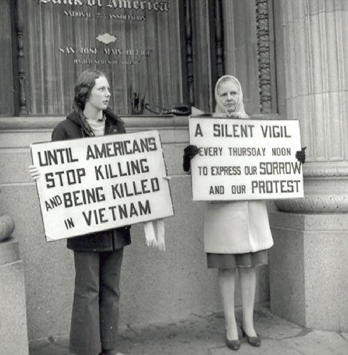 "1971, Vietnam War protests: Two demonstrators on silent vigil ""until Americans stop killing and being killed in Vietnam."""