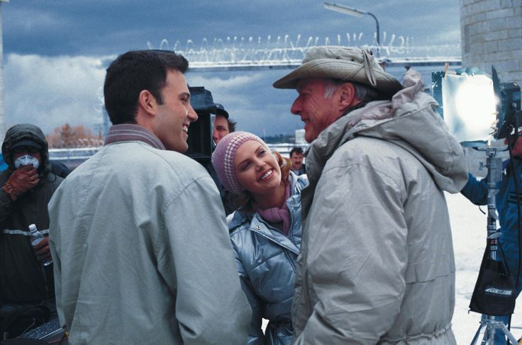 "On the set of ""Reindeer Games"", 2000.  L to R: Ben Affleck, Charlize Theron, director John Frankenheimer.  Frankenheimer was the director of legendary films like ""Birdman of Alcatraz"" and ""The Manchurian Candidate"".  Affleck was on the set every single day and shadowed Frankenheimer as he directed the movie."