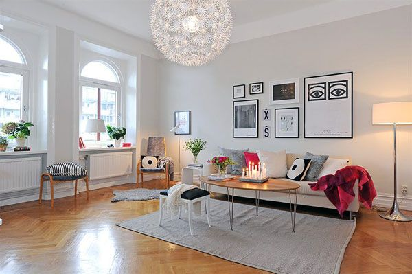 Modern, Contemporary, Elegant Scandinavian Room Designs : Large Living Room With White Wall Decorated With Flowers Colorful Pillows And Artistic Paintings